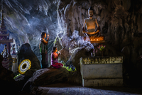 Asian girls lighting incense in temple