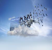 Credit card disintegrating into cloud in blue sky 11018049643| 写真素材・ストックフォト・画像・イラスト素材|アマナイメージズ