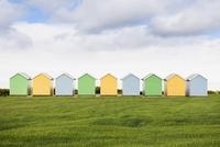 Multicolor shacks in field