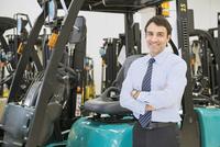 Hispanic businessman smiling in warehouse
