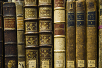 Close up of old leather bound books in library