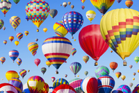 Hot air balloons floating in blue sky