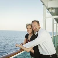 Caucasian couple hugging on boat deck