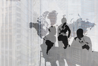 Silhouette of Caucasian business people near world map and cityscape