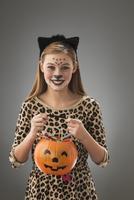 Caucasian girl wearing leopard costume for Halloween