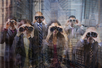Business people looking through binoculars at office window