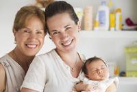 Three generations of Hispanic women smiling