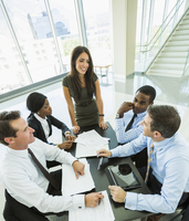 High angle view of business people talking in meeting