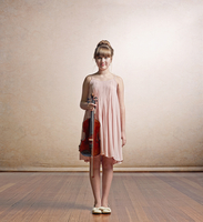 Caucasian girl holding violin