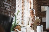 Hispanic businesswoman using digital tablet in office