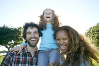 Family laughing together outdoors