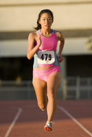 Japanese runner competing on racetrack