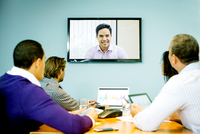 Business people having video conference in office meeting 11018054729| 写真素材・ストックフォト・画像・イラスト素材|アマナイメージズ