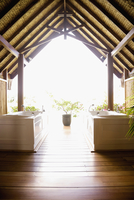Bathtubs under wooden arches in spa