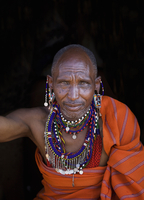 Black man wearing traditional jewelry and clothing