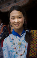 Smiling Asian girl wearing traditional clothing