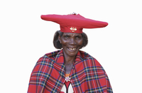 Black woman wearing traditional hat and cape