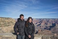Caucasian couple standing over Grand Canyon, Arizona, United States