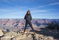 Caucasian woman standing over Grand Canyon, Arizona, United States