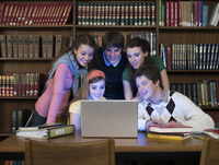 Students using laptop in library