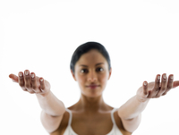 Close up of woman meditating with arms outstretched