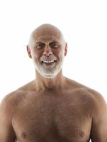 Close up of nude older man smiling