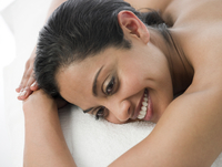 Smiling woman laying on massage table