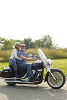 Older couple riding motorcycle