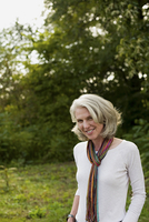 Older woman smiling in park