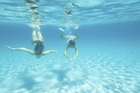 Underwater view of women swimming in ocean