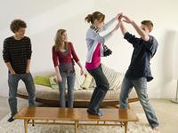 Friends dancing in living room