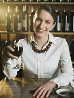 Caucasian woman drinking wine in restaurant