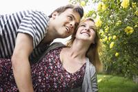 Caucasian couple hugging in garden