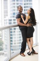Couple hugging on urban balcony