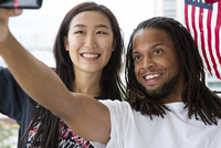 Couple taking selfie with American flag