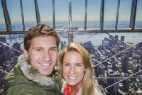 Caucasian couple smiling over New York cityscape, New York, United States