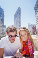 Caucasian couple reading map in New York City, New York, United States