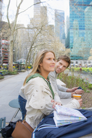 Caucasian couple relaxing in city