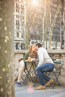 Caucasian couple kissing in city