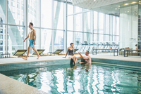 People relaxing in swimming pool