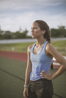 Mixed race athlete standing on sports field