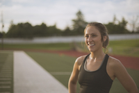 Caucasian athlete standing on sports field