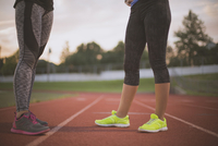 Athletes standing on track on sports field