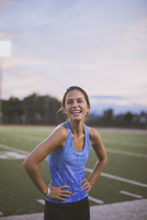 Mixed race athlete laughing on sports field