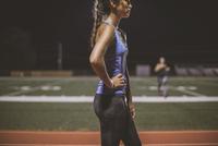 Athlete resting on sports field