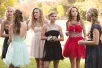 Teenage girls talking before prom