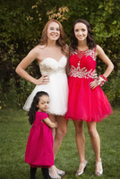 Teenage girls and sister smiling before prom