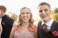 Teenage couple smiling before prom