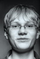 Close up of smiling teenage boy with eyeglasses