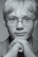 Close up of teenage boy resting chin in hands